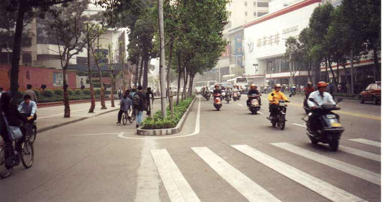 An accessible travel chain begins with safe streets and sidewalks. This street in Foshan, China, has separate rights-of-way for pedestrians, human-powered vehicles, and motor-powered vehicles.