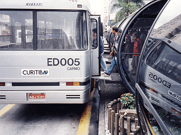 Express buses in Curitiba, Brazil, exemplify universal design. All passengers, including those with disabilities, quickly board with level entry. Similar Bus Rapid Transit (BRT) systems operate in Quito, Ecuador; Bogota, Colombia, and a growing number of cities around the world.<br>Photo by Charles Wright, Inter-American Development Bank.
