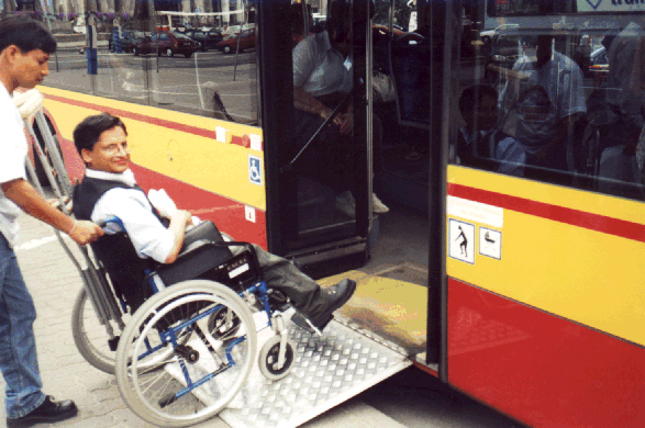 This low-floor bus in Warsaw, Poland, uses an inexpensive hinged ramp which provides easy boarding for passengers with disabilities.