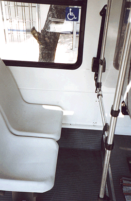 One such feature is this priority seating located behind the driver where there is extra leg room and it is easier for blind passengers to hear the driver call out key stops.<br>Photo by T. Rickert, courtesy of DFID (UK) and TRL (UK).