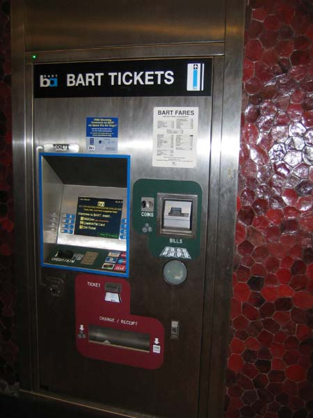 Ticket vending machines should be low enough for use by wheelchair users and all short persons, as illustrated by the good design of this machine at a BART station in the San Francisco Bay area, USA.