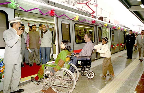 Advocates Anjlee Agarwal (left) and Sanjeev Sachdeva board the accessible Delhi Metro on its inaugural run.<br>Photo courtesy of Sanjay Sakaria and Samarthya, from Amar Ujjala Indian Daily