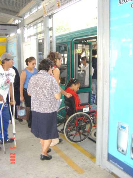 Pre-paid passengers inside a station board a high-capacity BRT bus in León.<br>This and above photo courtesy of Sistema Integrado de Transporte Masivo de León