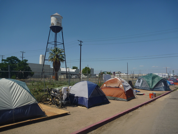 A Homeless Encampment situated in Fresno, California, USA. As in many US cities, such encampments are criminalized in the downtown core, but concentrated and tolerated in the industrialized outskirts. Photo by Christopher Herring.